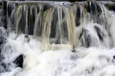 A close-up view of a waterfall is shown. Stock Photo