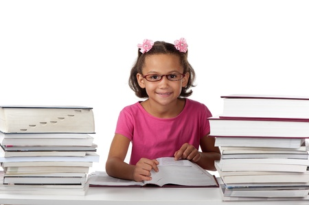 volumes: A young girl with spectacles enjoys studying large volumes of books