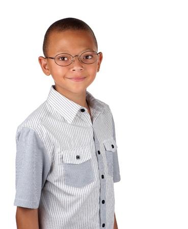 A friendly teenage boy wears spectacles for better eyesight.