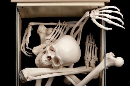 One open drawer reveals skeletal bones that were previously hidden. Stock Photo