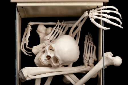 One open drawer reveals skeletal bones that were previously hidden. Stock Photo