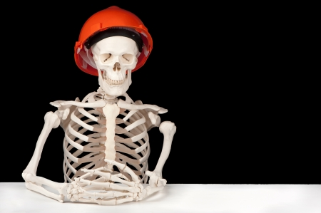 lull: A skeleton with hard hat symbolizes death to the building industry