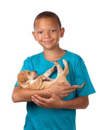 boerboel dog: A young boy enjoys holding his puppy dog in his arms