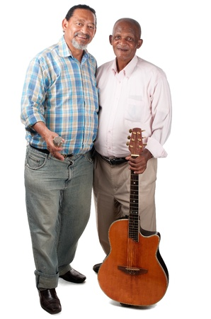Two smiling old men pause for a moment with their guitar and microphone in rest mode. photo