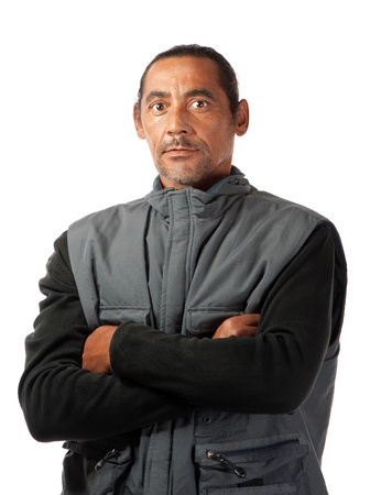 A stern faced man with attitude stands upright