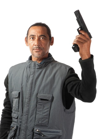 extremist: An aggressive looking man wields a gun in his left hand.
