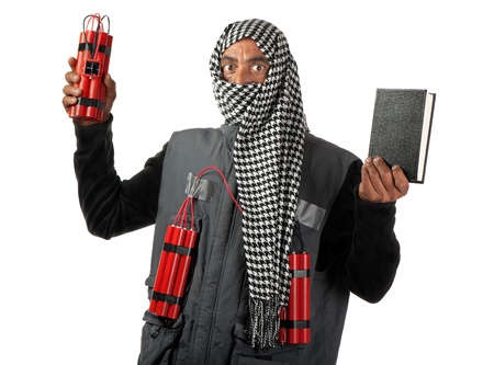 A man strapped with with dynamite also holds a manual in his hands.