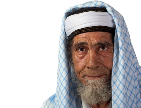 A senor man in traditional garment appears in thought. Stock Photo