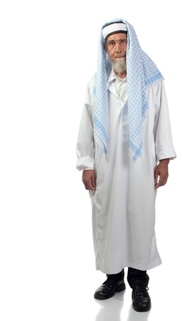 arab man: A spiritual senior man with beard and a headdress stands upright.