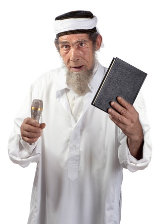 A senior with a microphone and book delivers a message  Stock Photo