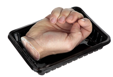 A hand in a tray could be offered to cannibals, or used to showcase punishment for stealing  Stock Photo