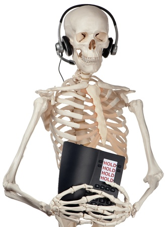 permanently: A skeletal phone operator has a phone permanently on hold