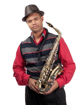 A three quarter view of a young saxophonist is shown. Stock Photo