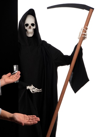 The grim reaper is pleasantly surprised when it is welcomed at the door. Stock Photo