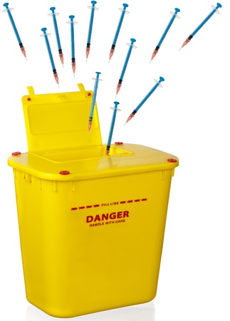 Used syringes and needles head straight for the appropriate container. Stock Photo
