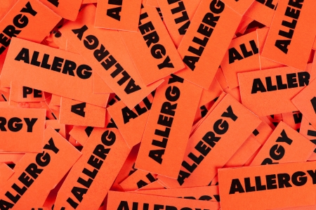 A closeup view of allergy labels is shown.