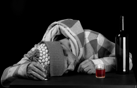 A habitual alcoholic drinker fell asleep before finishing his bottle  Stock Photo