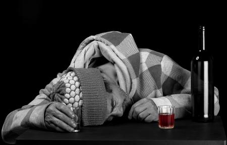 A habitual alcoholic drinker fell asleep before finishing his bottle  Stock Photo