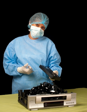 A surgeon shows that it is impossible to revive old technology such as video cassette recording devices