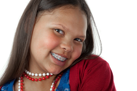 A teenage girl is happy to show her braces. Banque d'images