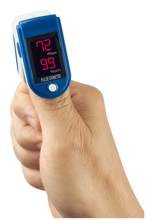 A pulse oximeter attached to a patient's thumb displays normal values.