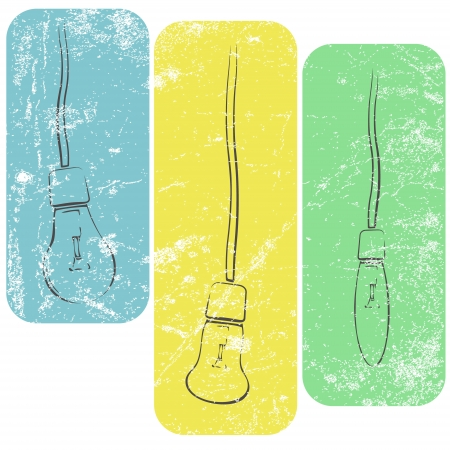 Three grunge light bulbs on wires in light colors