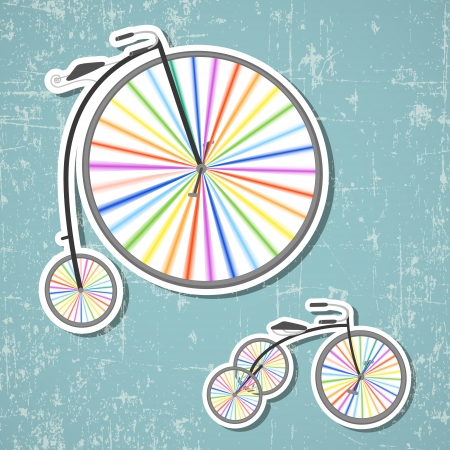 Two retro bicycles with rainbow colored wheels on grunge background