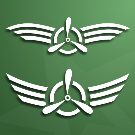 Two abstract airforce emblems on green background; paper look