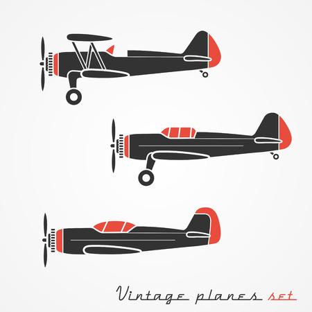biplane: Set of three retro planes silhouettes on white background