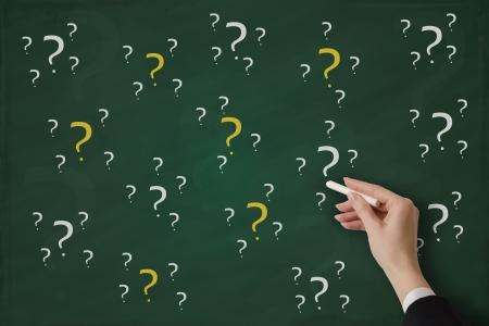 Questions handwritten on a blackboard Stock Photo - 17799743