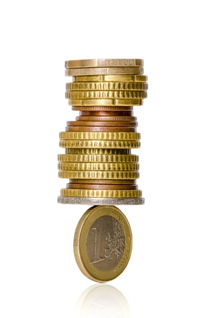 Euro coins in balance isolated on white background Stock Photo - 17951781