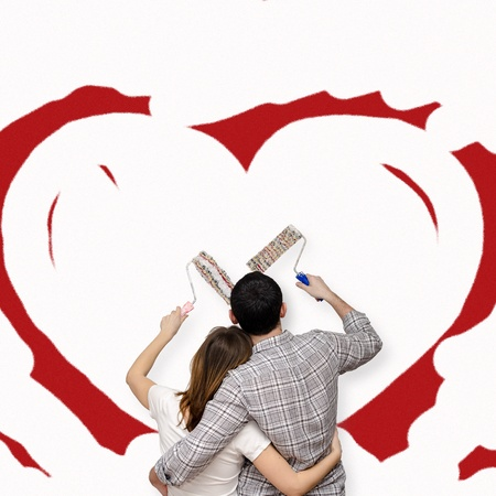 Young family painting together the love photo