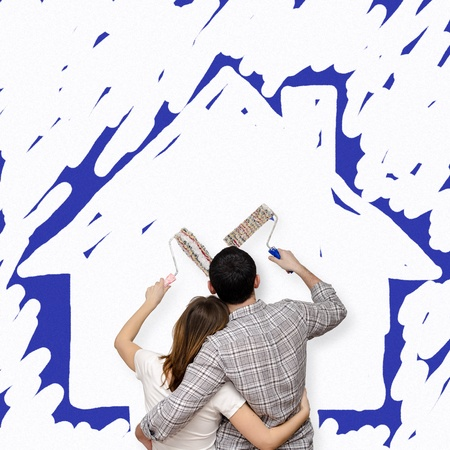 Young couple painting the future home photo
