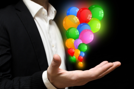 releasing: Man releasing colorful balloons Stock Photo