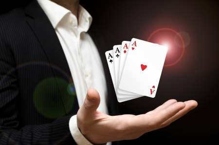 Man holding four poker aces Stock Photo - 18230023