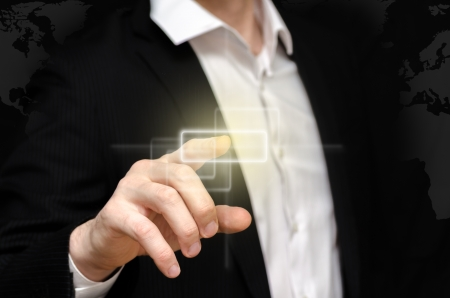 Man touching a small blank technology advanced display Stock Photo - 18752074