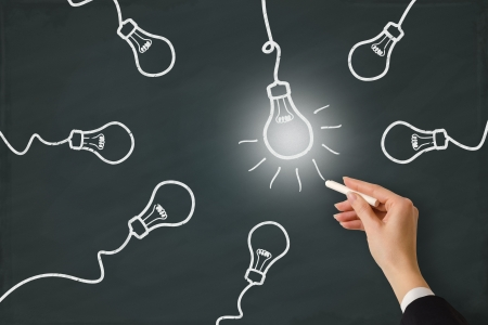 Idea light bulb word sketched on a white board  Banque d'images