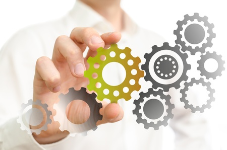 Man adding the important missing cogwheel photo