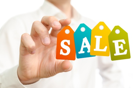 Man holding sale colored labels on white background Stock Photo