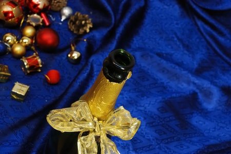 backgruond: Colorful christmas decoration with champagne on blue backgruond. close up Stock Photo
