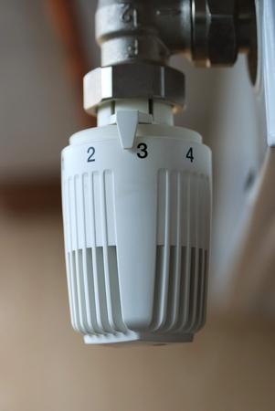 optimal: Thermostatic radiator valve set to optimal temperature. Close up