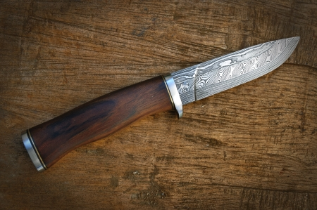damascus: Hand made damascus knife on wooden background