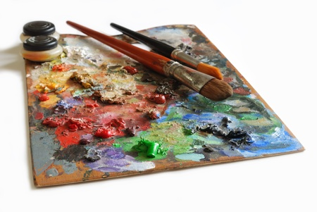 fine art painting: Artistic color pallete and brushes on white background Stock Photo