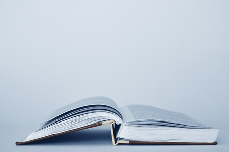 publish: Open book on a white table, close up Stock Photo