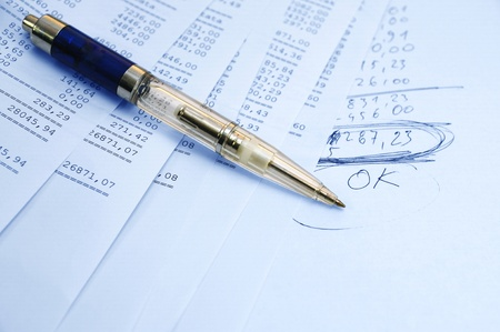Prints of financial report on a sheets and pen Stock Photo - 10760507