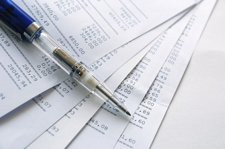 Prints of financial report on a sheets and pen photo