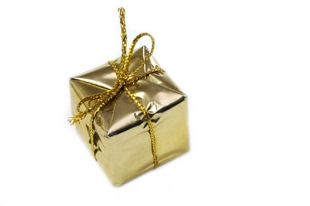 Golden gift box isolated on white background Stock Photo - 11595276