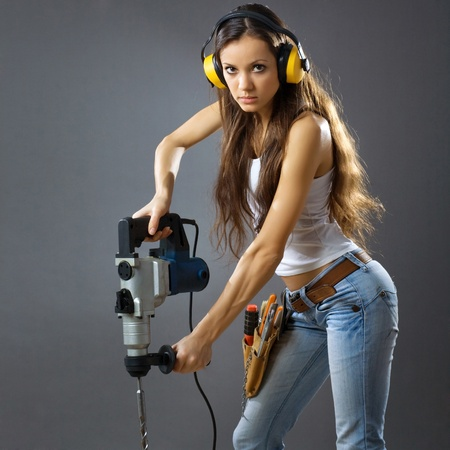 female architect: sexy young woman construction worker