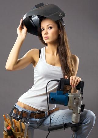 trabajador de la construcción de una mujer joven sexy
