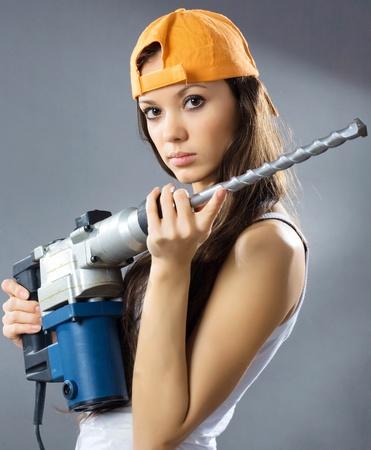 obrero: trabajador de la construcci�n de una mujer joven sexy
